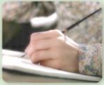 photo.main qui ecrit.jpg